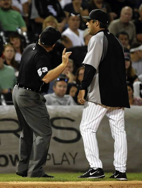 Sox manager Robin Ventura is ejected while arguing after the Rangers' Ian Kinsler hit an inside-the-park home run in the third inning.