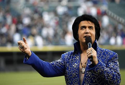 Elvis impersonator Doug Church sings the Star Spangled Banner.