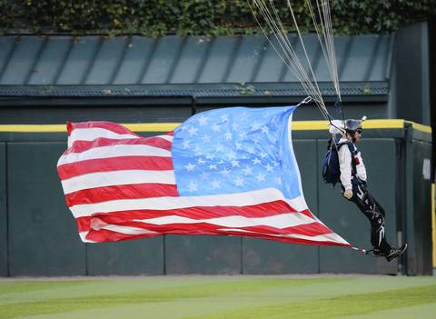 The Frog-X Parachute Team descends into the stadium.