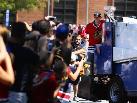 Riding in on the back of a Zamboni, Patrick Kane shows the Stanley Cup to fans at the Town of West Seneca ice rink in Buffalo.
