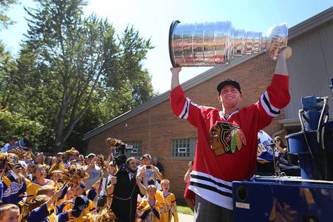 Riding in on the back of a zamboni, Patrick Kane shows the Stanley Cup to fans at the Town of West Seneca ice rink in Buffalo on August 24.