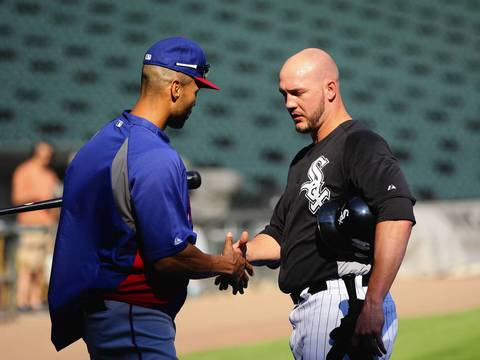 The Rangers' Alex Rios greets Tyler Flowers.