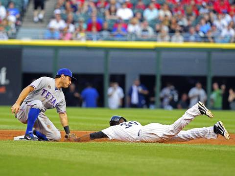 Alejandro De Aza is tagged out by the Rangers' Ian Kinsler during the first inning.