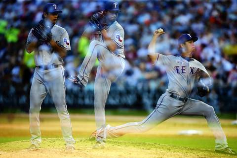 Rangers starting pitcher Yu Darvish throws a pitch against the Sox in the second inning.