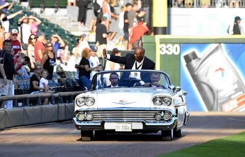 Former Sox player and Heisman Trophy winner Bo Jackson waves to the crowd as a 1958 Chevrolet drives him from center field to home plate before the 2013 Civil Rights Game.