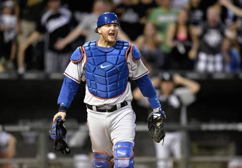 Rangers catcher A.J. Pierzynski reacts after tagging out Alexei Ramirez when he tried to score on a single hit by Paul Konerko during the fourth inning.