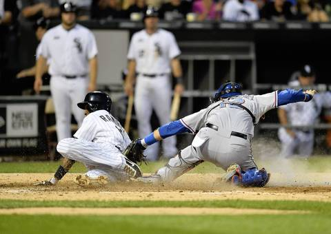 Rangers catcher A.J. Pierzynski tags out Alexei Ramirez at home plate as he tries to score from second base on a single hit by teammate Paul Konerko during the fourth inning.