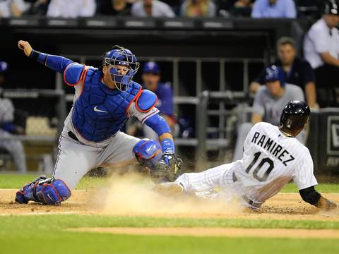 Alexei Ramirez is tagged out at home by Rangers catcher A.J. Pierzynski.