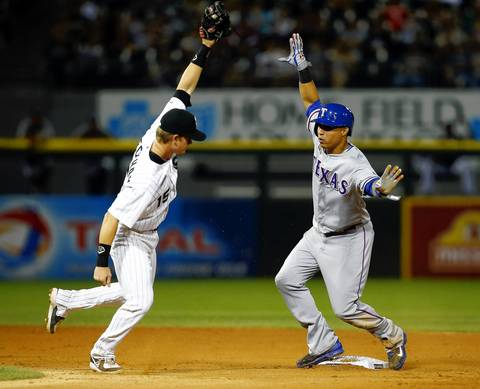 The Rangers' Leonys Martin and Gordon Beckham react after Martin stole second base.