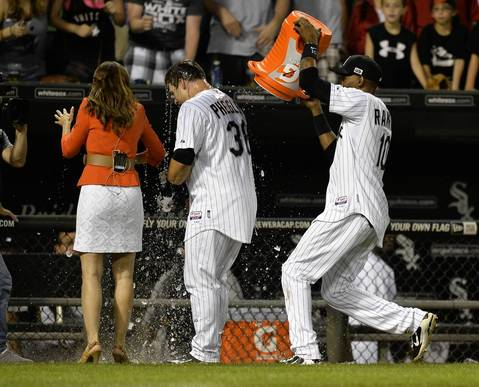 Alexei Ramirez douses Josh Phegley with ice water as he is interviewed by a reporter after hitting a game-winning, RBI single that scored Avisail Garcia.