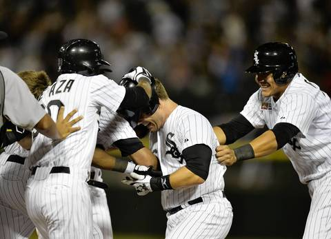 Josh Phegley is mobbed by Alejandro De Aza, Avisail Garcia and others after he hit a game-winning, RBI single.