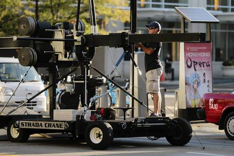 Crews unload camera equipment as they prepared for filming scenes for Transformers 4 along East Cermak Road near McCormick Place in Chicago.