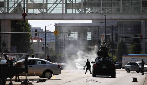 Film crews prepare for an explosion in the middle of Martin Luther King Dr. at McCormick Place during the filming of 'Transformers 4' in Chicago on Aug. 24.