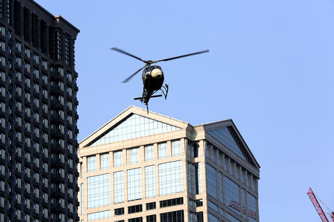 A helicopter assists the filming of 'Transformers 4' in downtown Chicago on Aug.25.