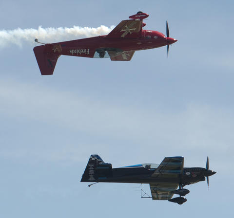 Jack Knutson (top) and Rob Holland delight the heavy crowd during the Lehigh Valley Airshow at Lehigh Valley International Airport on Sunday.