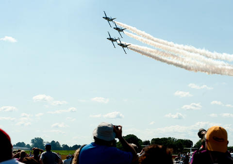 The Black Diamond Aerobatic Team flies in over the crowd at the Lehigh Valley Airshow on Saturday.