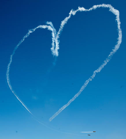 The Firebirds Aerobatic Team draw a heart above the Lehigh Valley International Airport as part of the Lehigh Valley Airshow on Saturday.
