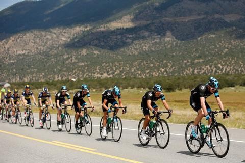 Chris Froome of Great Britian and Sky Procycling (L) rides in the peloton during stage two of the 2013 USA Pro Cycling Challenge on in Breckenridge, Colorado.