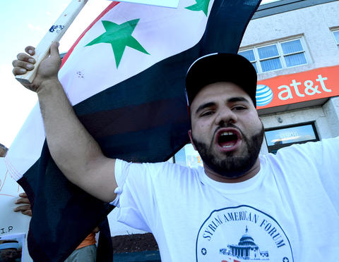Members of the Syrian American Society protest U.S. involvement in Syria. They are at the inetersection of MacArthur Road and Grape Street. this is Fayez Abboud of Allentown.