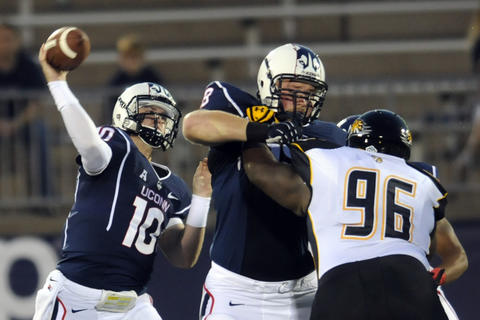 Chandler Whitmer lets fly a pass early in the game.UConn football met Towson University at Rentschler Field for the season opener. STEPHEN DUNN|sdunn@courant.com