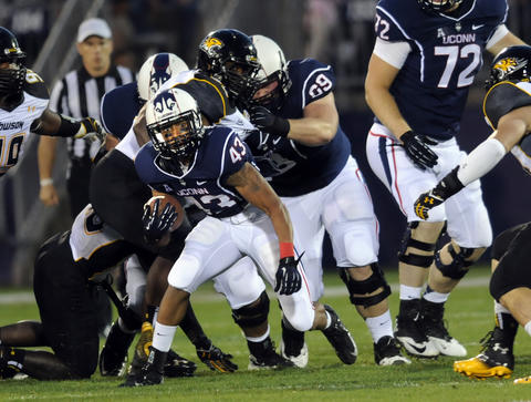 Lyle McCombs moves the ball early in the game. UConn football met Towson University at Rentschler Field for the season opener. STEPHEN DUNN|sdunn@courant.com