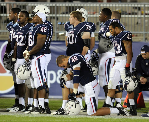 A dejected UConn football team sits on the sidelines in the closing seconds of their loss to Towson, 33-18. UConn football met Towson University at Rentschler Field for the season opener. STEPHEN DUNN|sdunn@courant.com