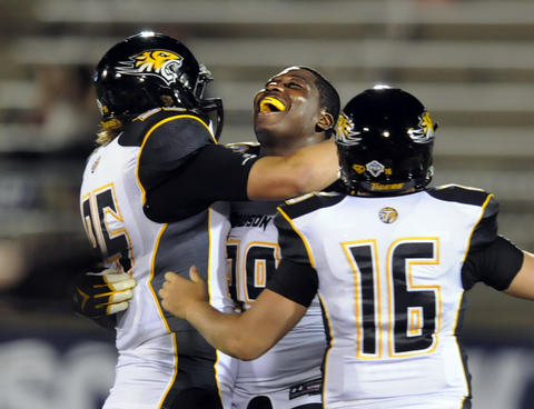 Towson's Jon Desir greets his teammates as time runs out and Towson pulls off an upset, beating UConn, 33-18.