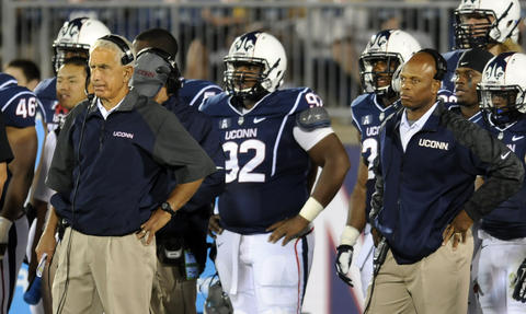 UConn coach Paul Pasqualoni does not look happy on the sideline against Towson University at Rentschler Field.