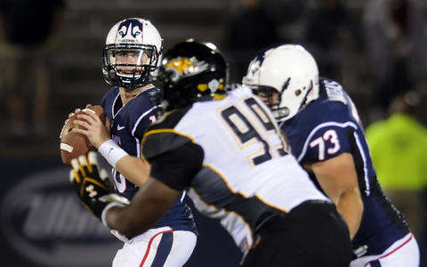 Chandler Whitmer looks for a receiver late in the fourth quarter, but it was too little to late. UConn lost, 33-18.