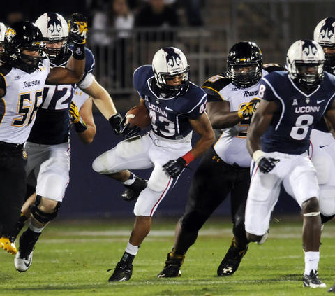 Lyle McCombs tries to break through on a run in the second quarter against Towson.