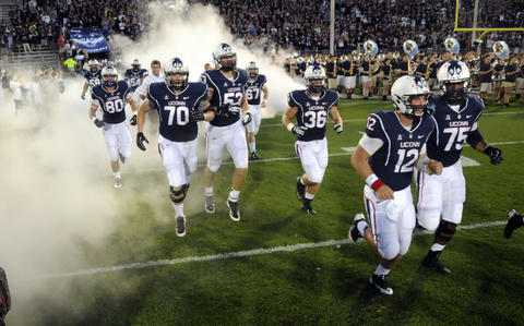 The UConn football season began Thursday night against Towson University at Rentschler Field. UConn lost, 33-18.