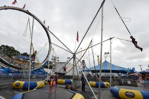 Children enjoy the Bungee Jumper ride during The Great Allentown Fair on Wednesday, August 28, 2013.