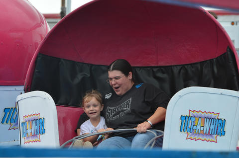 Mother and daughter Savannah Thompson 3 (left) and Kelly Thompson, both of Schnecksville enjoy the tilt-a-whirl during The Great Allentown Fair on Wednesday, August 28, 2013.