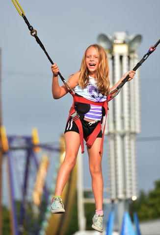 Ava Tatulli, 8, of Toms River enjoys the Bungee Jumper ride during The Great Allentown Fair on Wednesday, August 28, 2013.
