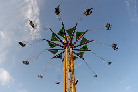 Thrill seekers ride the Vertigo high above The Great Allentown Fair on opening day Tuesday afternoon.
