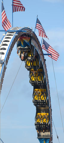 Thrill seekers hang upside-down at the Fire Ball at The Great Allentown Fair on opening day Tuesday afternoon.