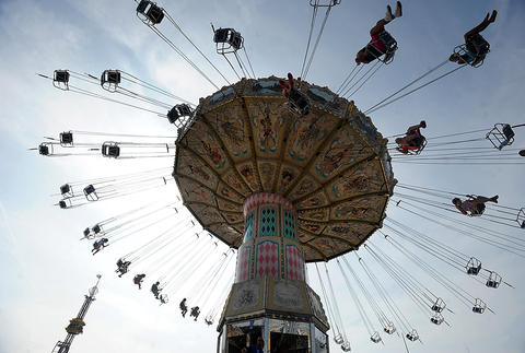 Thrill seekers ride the Wave Swinger at The Great Allentown Fair.