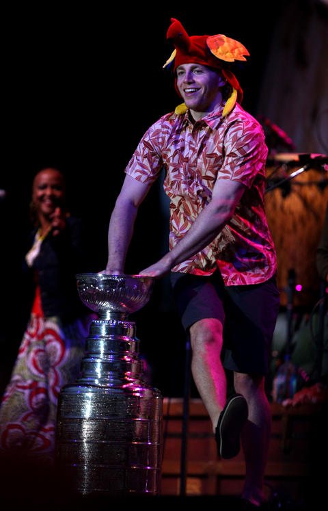 Blackhawks player Patrick Kane dances around the Stanley Cup during a Jimmy Buffett concert at FirstMerit Bank Pavilion at Northerly Island.