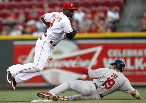 Cincinnati Reds second baseman Brandon Phillips (L) avoids a hard sliding St. Louis Cardinals' Jon Jay but is unable to turn the double play during the third inning of their MLB National League baseball game at Great American Ball Park in Cincinnati, Ohio, September 3, 2013.