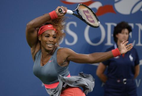 US tennis player Serena Williams plays a points against Spain's Carla Suarez Navarro during their 2013 US Open women's singles match at the USTA Billie Jean King National Tennis Center in New York on September 3, 2013.