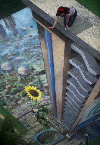 A woman poses by the work of British artist Julian Beever, specialized in pavement drawings, wall murals and realistic paintings, made in a shopping center in Medellin, Antioquia department, Colombia on September 5, 2013. Beever made the painting using colour chalks.