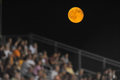 A nearly full moon lights the stands during the Northwestern Lehigh game against Southern Lehigh on Friday, September 24, 2010 at Northwestern Lehigh High School.