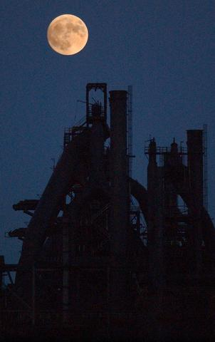 The full moon rises over the blast furnance at Bethlehem Steel in South Bethlehem.