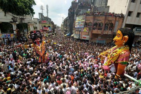 Indian revellers gather around idols as they are paraded to celebrate the Marbat festival in Nagpur on September 6, 2013. The festival, which is unique to the central Indian city involves the construction, parading and burning of statues or idols meant to represent the forces of evil. The 130-year-old Kali marbat and 126-year-old Pivli marbat have their roots in both mythology and history.