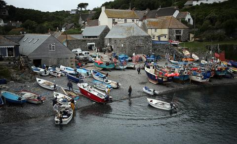 Fishermen prepare their boats and kit prior to the final fortnightly fishing competition of the year in Cadgwith on September 5, 2013 in Cornwall, England. The summertime competition to catch the heaviest fish of a chosen type, (for this final the fish was bass) allows locals and visitors the chance to fish for fun and a cash prize, with the catch cooked in a pot at the end of the night on some occasions. Set on the Lizard peninsula in Cornwall, the village of Cadgwith, which was established in medieval times, owes its existence to the fishing industry. However, whilst fishing remains an important part of village life today, tourism is also now a major source of income for the inhabitants.