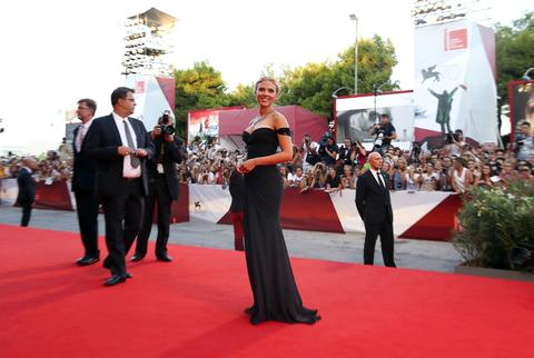Scarlett Johansson poses during the red carpet of the movie 'Under the Skin,' directed by Jonathan Glazer, during the 70th Venice Film Festival.