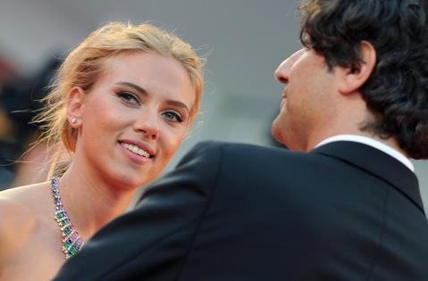 Scarlett Johansson (L) and British director Jonathan Glazer (R) arrive for the premiere of 'Under the Skin' at the 70th annual Venice International Film Festival.