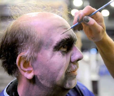 Jay Stoddart, a make-up artist at Dorney Park, applies make-up to Rick Kula, who plays Insane Norman at Dorney Park's Halloween Haunt, at ParaFest 2013 held at the Sands Bethlehem Events Center. It will run from Friday, September 6 through Sunday, September 8, 2013.