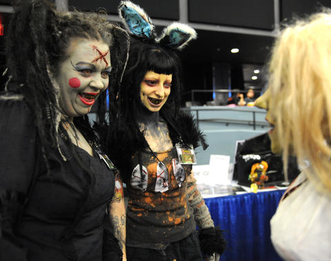 "(L to R) Abra Cadabra and Rabbit, from the Hotel of Horror in Saylorsburg, look at a fellow ""Zombie"" at ParaFest 2013 held at the Sands Bethlehem Events Center.  It will run from Friday, September 6 through Sunday, September 8, 2013."