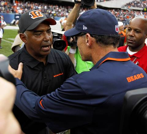 Bengals coach Marvin Lewis and Bears coach Marc Trestman greet each other after the game.